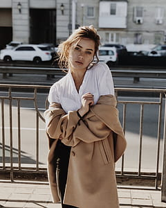 woman wearing browns suede button-up topcoat