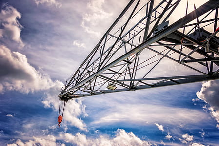 black steel crane with sky background