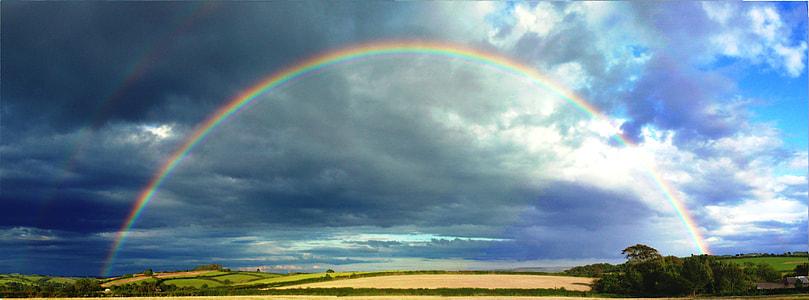 rainbow under blue sky