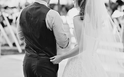 grayscale photo of wedding couple