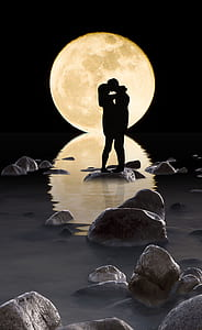 silhouette photo of man and woman with moon