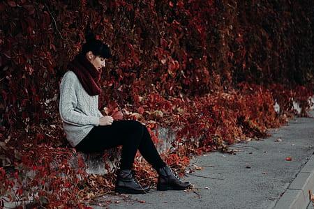 Woman Sitting on the Pavement