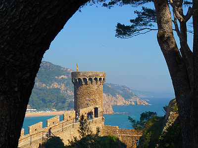 castle turret beside ocean