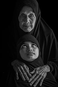 grayscale photo of woman and girl wearing black headscarves