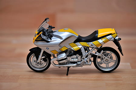silver and yellow standard motorcycle decoration