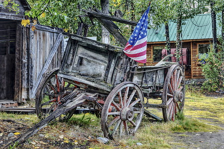brown wooden wagon with USA flag during daytime