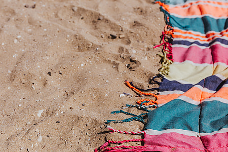 Colorful beach towel on the sand