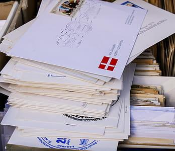 pile of envelops on top of folders