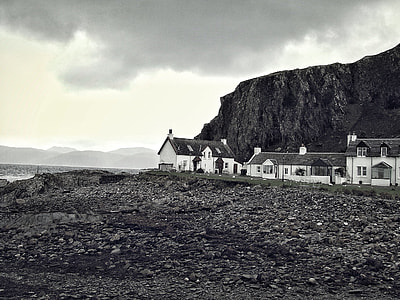 grayscale of house on seashore