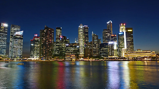 cityscape by water during nighttime