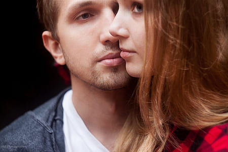 man and woman close to each other