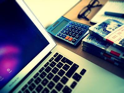 gray calculator beside MacBook Air