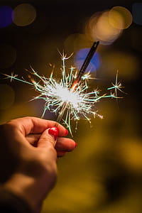 Person Holding Gray Firework