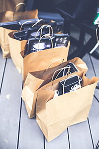 five filled paper bags