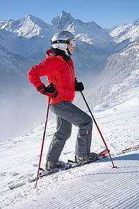 woman in jacket walking on snow