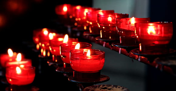 focus photography of clear glass holder with candles