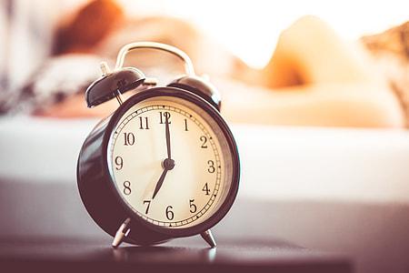 Vintage Alarm Clock and Sleeping Woman