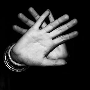 greyscale photography of humans hands