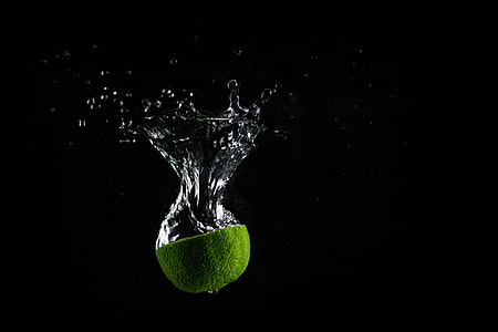 Lime In Water with Black Background