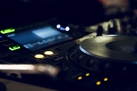 selective focus photography of turned on DJ controller