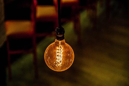 bokeh shot of orange LED light bulb