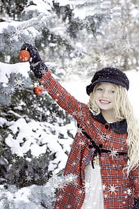 girl in orange and black plaid button-up coat