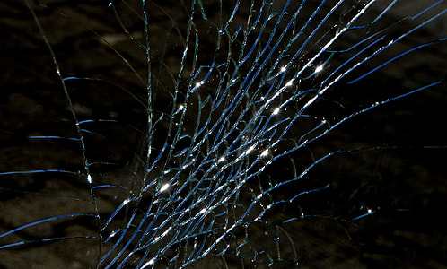 close up photography cracked glass