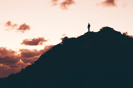 silhouette photography of person on top of mountain