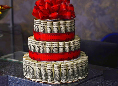 US dollar banknote cake on marble table