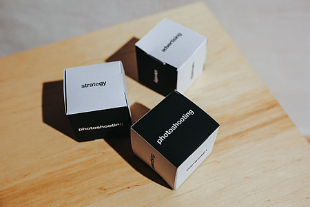 Little paper boxes with words on them