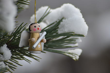 shallow focus photography of angel Christmas tree decor