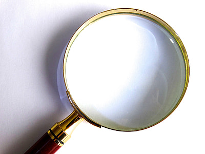 magnifying glass on top of white surface