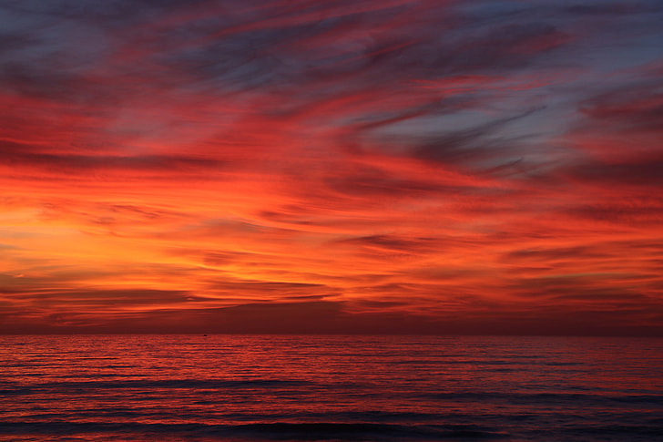 A red sky sunset over the ocean