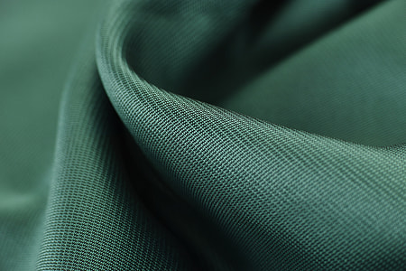 green textile close-up photography