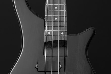 close up photography of black 4-string bass guitar