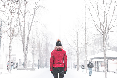 Woman Standing in The Middle of The Park in Snowy Weather