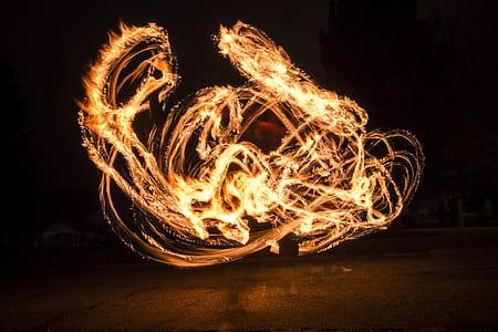 fire dance at nighttime