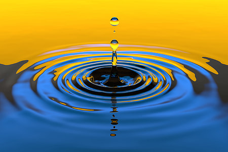Water droplet splash in yellow and blue