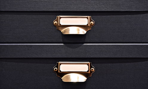 black and brass-colored drawers