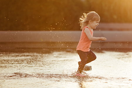 girl playing on water