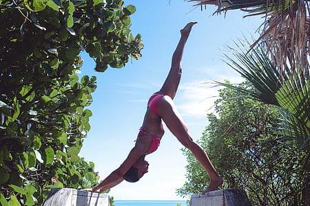 woman wearing pink bikini swimsuit