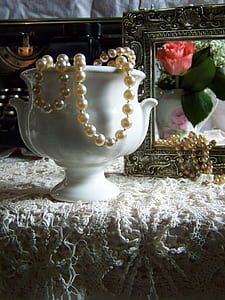 beaded pearl necklace on vase