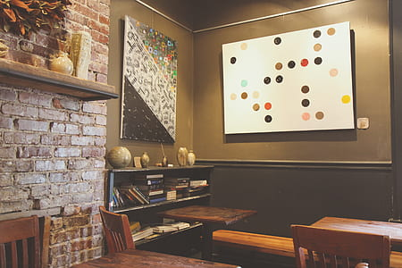 multicolored abstract painting near brown wooden tables