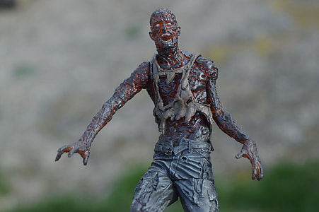 gray and red zombie figure