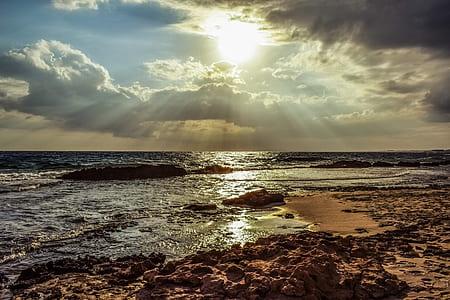 body of water waving under sunrise