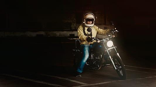 Man Wearing White Full Face Helmet Riding on Standard Motorcycle