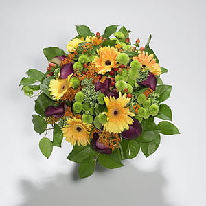 purple, yellow, and green daisies, mums and calla lilies bouquet
