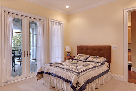 empty bed near doorway