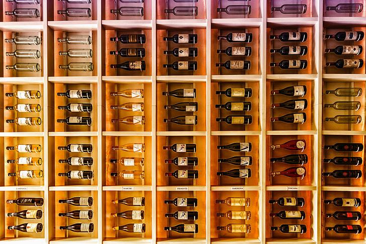 Wine bottles being kept in large rack for storage
