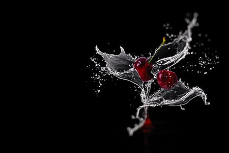 timelapse photography of cherries and water